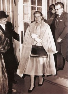Princess Grace Kelly in Philadelphia hiding her baby bump with the iconic Hermes Kelly Bag, 1956  (Photo courtesy of Rex Features)