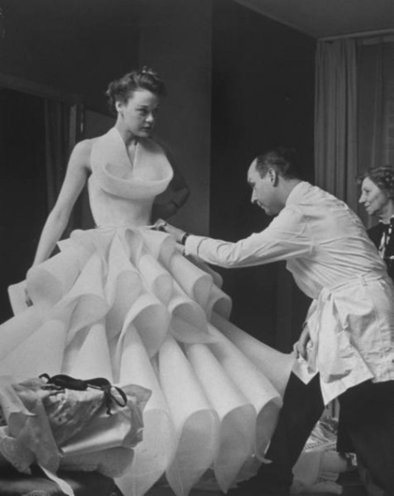Christian Dior fitting a client in the 1950's