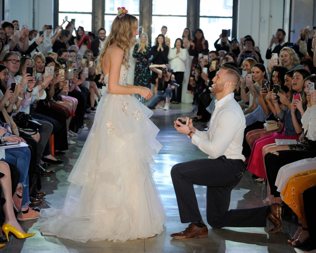 Chad Stapleton proposes to model girlfriend Nicole Kaspar on the runway of the Watters Show (Photo courtesy of The Knot)