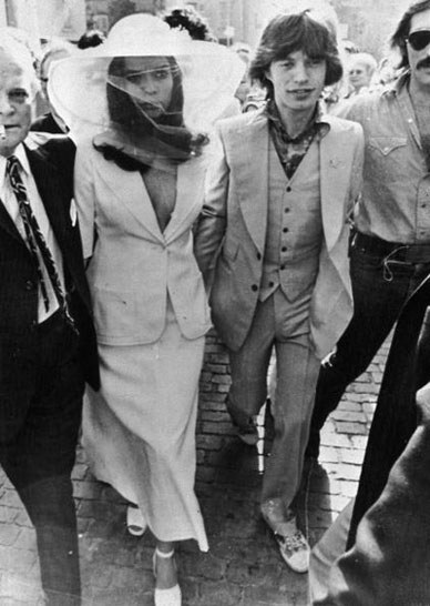 Bianca Jagger in a white wedding suit (Photo Courtesy of Glamour)