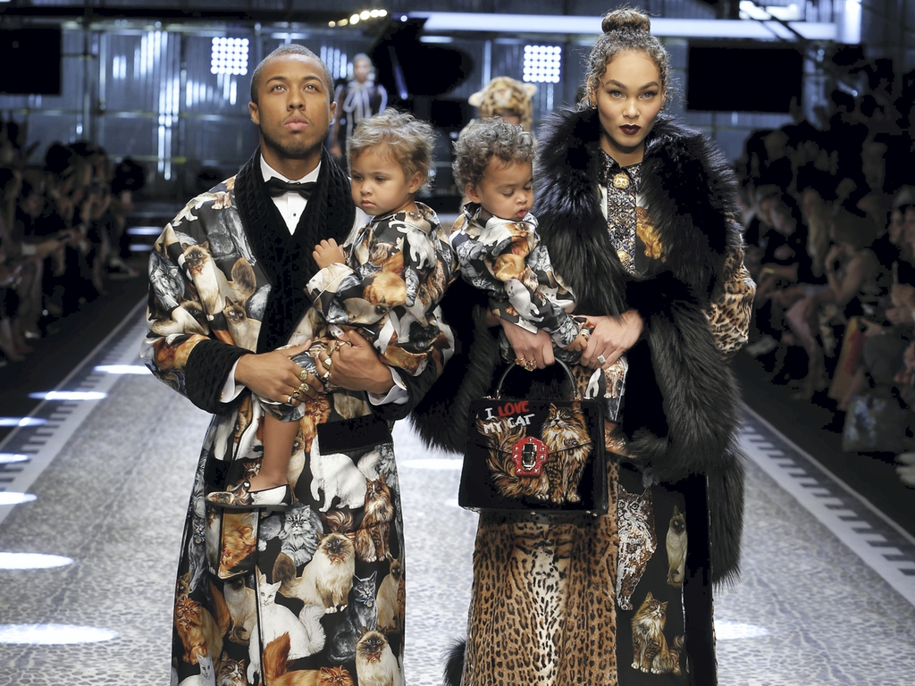 Jason and Amanda Harvey with their twins at the Dolce & Gabbana Fall 2017 show (Photo courtesy of designer)