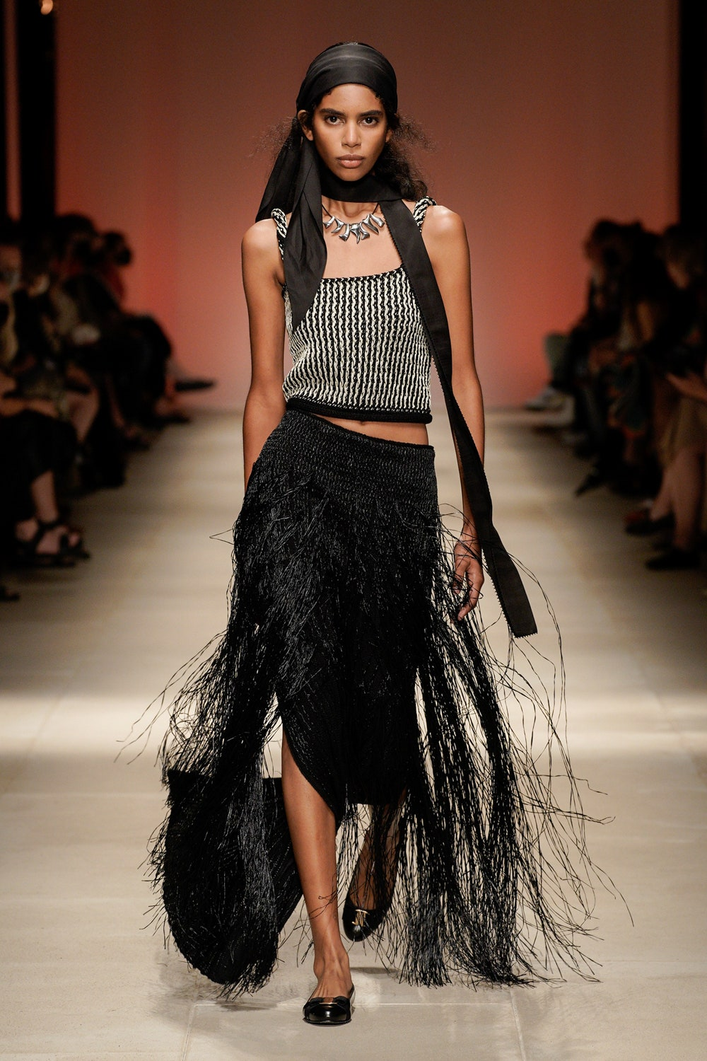 A look from Salvatore Ferragamo's spring 2022 Collection. Photo Credit Vogue Runway..2