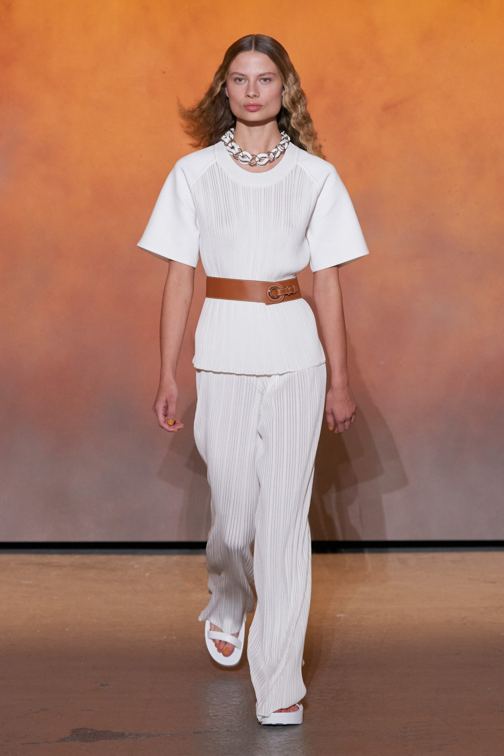 A look from Hermès' Spring 2022 collection. Photo Credit Vogue Runway