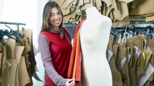Fashion Designer Draping with Patterns Around Her - From iStock