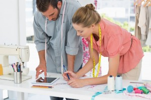 Male and Female in Design Studio studying Tablet - Fashion Business - shutterstock_168163514